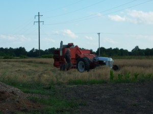 Ford 8N pulling the AC 72 Combine