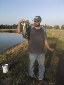 www.JLMissouri.com Joe with bass at Sawmill pond